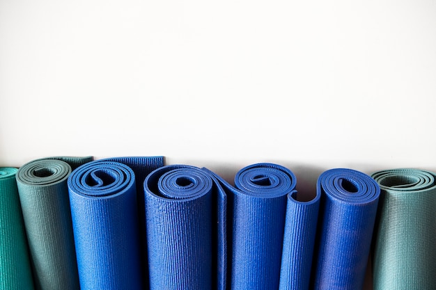 Rolls of yoga mats at a fitness center