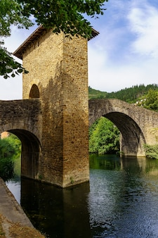 Roman church and bridge over the river in balmaseda basque country spain. europe.