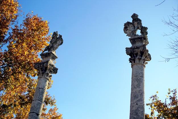 Roman columns with statues of hercules and julius caesar on alameda de hercules, seville, spain.