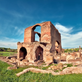 Roman landscape with old brick ruins on appia way