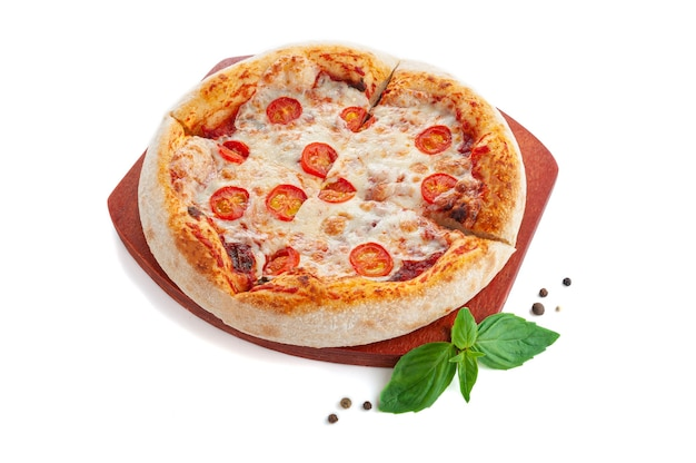 Roman pizza with cheese, salami and tomatoes on a wooden tray. decorated with basil and spices. white background. isolated.