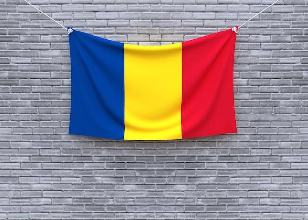 Romania flag hanging on brick wall