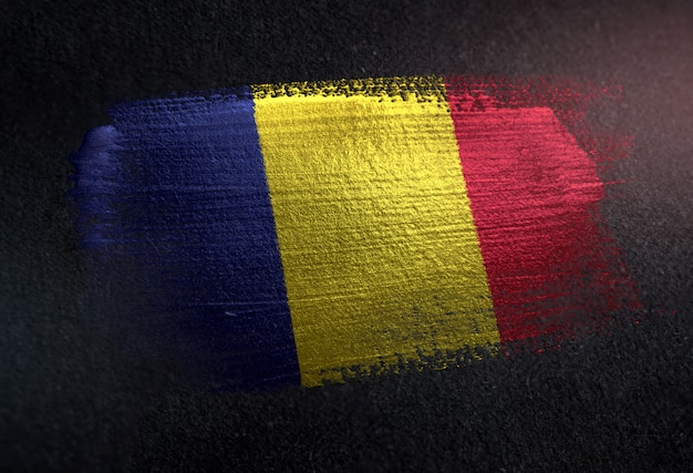 Romania flag made of metallic brush paint on grunge dark wall