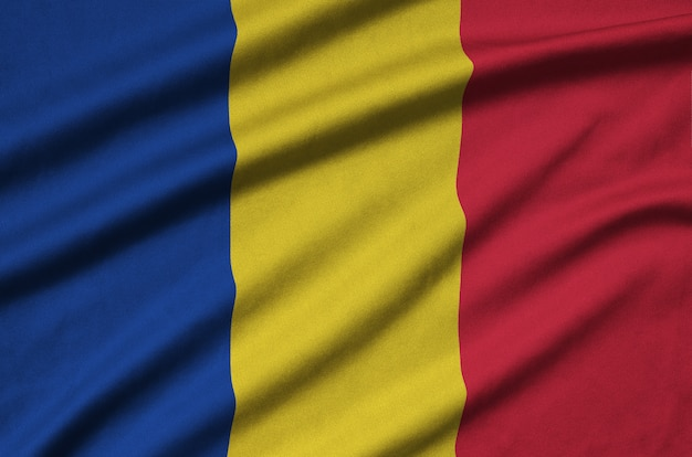 Romania flag with many folds.