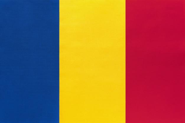 Romania national fabric flag, symbol of international world european country.