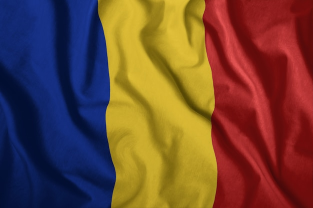 The romanian flag is flying in the wind