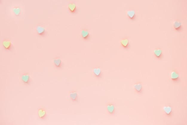 ハートとロマンチックな抽象的なピンクの背景。愛、デート、バレンタインデーのコンセプト