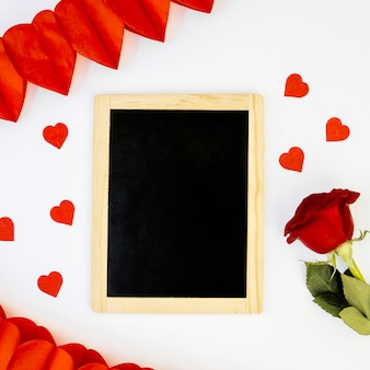 Romantic arrangement of blackboard and rose