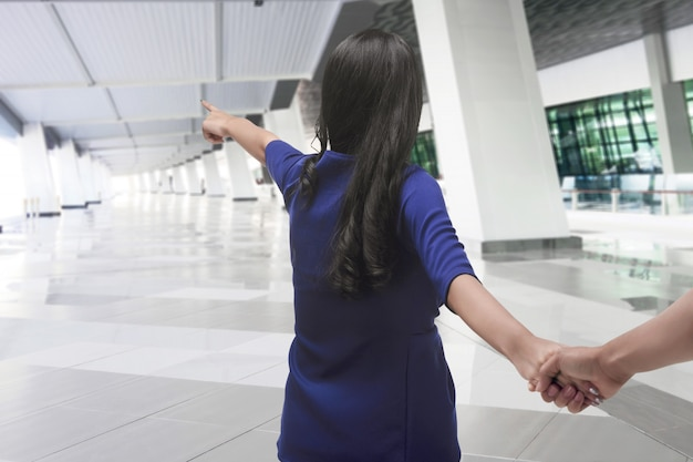 Romantic asian couple tourist holding hands