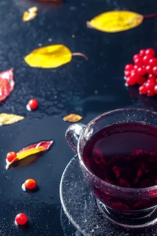Romantic autumn cup of tea with  leaves