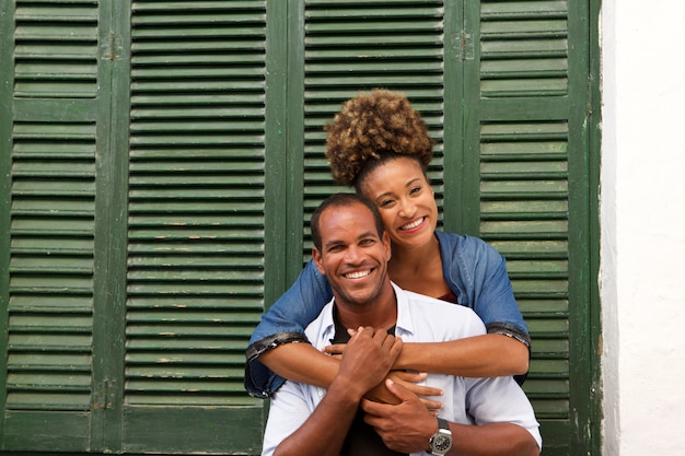 Romantic beautiful couple in embrace laughing