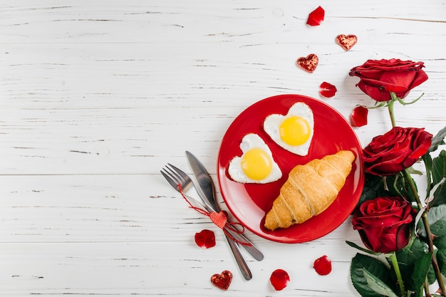 Romantic breakfast on light wooden table