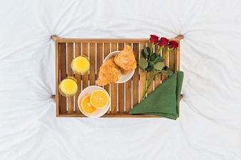 Romantic breakfast on wooden tray