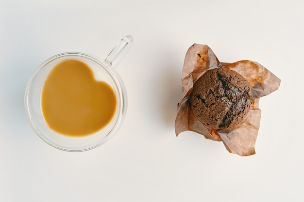 Romantic breakfast for valentines day coffee with milk and chocolate muffin hot cocoa in mug in shap...