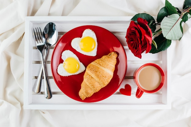Romantic breakfast on white tray