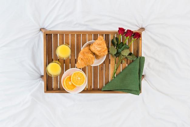 Romantic breakfast onwooden tray