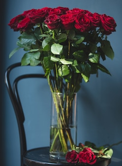 Romantic bunch of red velvet roses inside a vase with wate