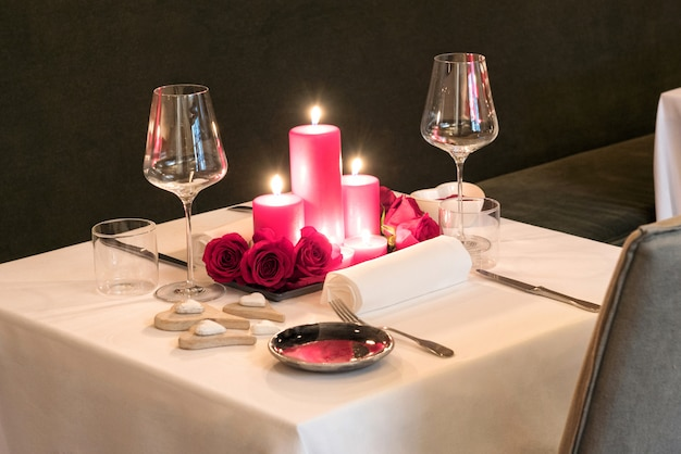Romantic candlelit table setting for two