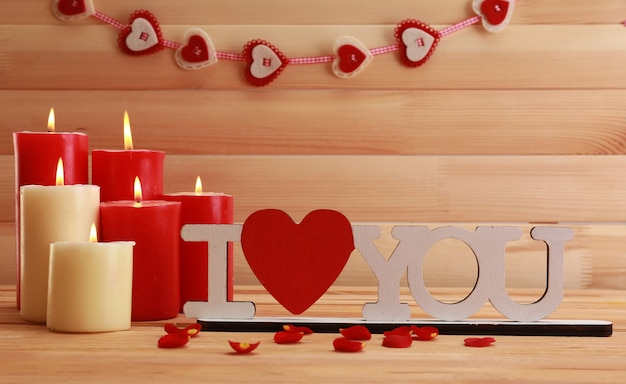 Romantic candles on wooden, love concept