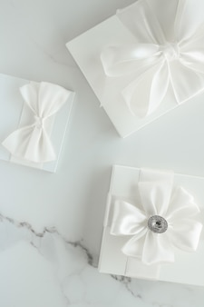Romantic celebration lifestyle and holiday present concept  luxury wedding gifts on marble
