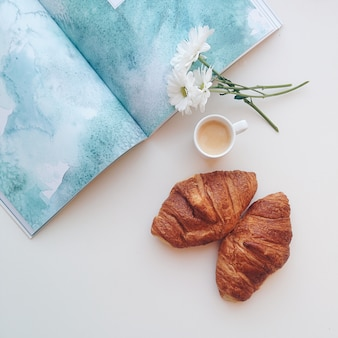 Romantic coffee break with croissants