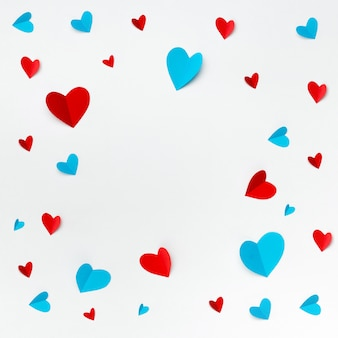 Romantic composition made with red hearts on white background with copyspace for text