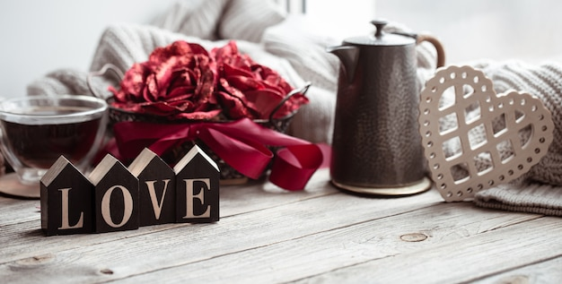 A romantic composition for valentine's day with the decorative word love and decor details.