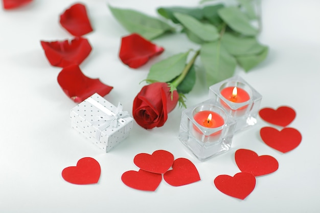 Romantic concept .gift box, burning candle and red rose . photo with copy space.