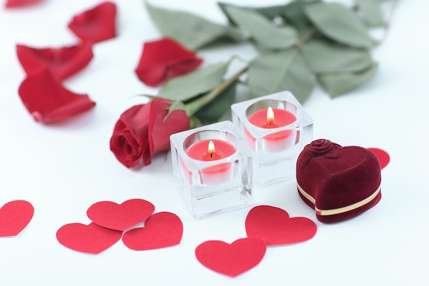 Romantic concept . ring, candles and rose on white background.
