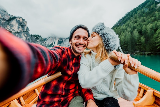 Romantic couple of adults in love taking a selfie on a boat