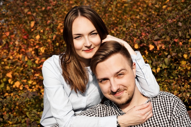 Romantic couple in the autumn park - sunny day - love, relationship and dating concept