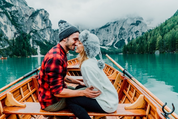 Romantic couple on a boat on lake