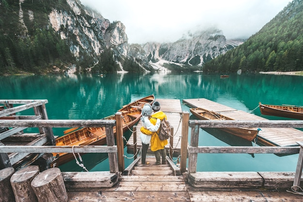 Romantic couple on a boat visiting an alpine lake at braies italy.