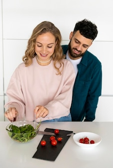 Romantic couple cooking together at home