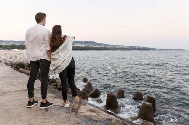 Romantic couple enjoying the view together and holding hands