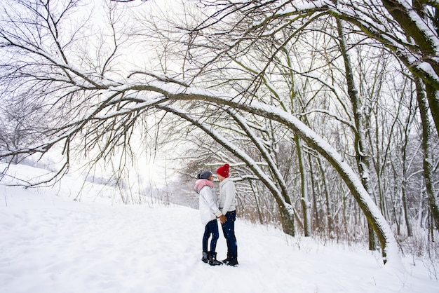 Romantic couple going to kiss in winter outdoors