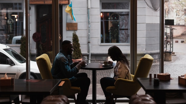 Romantic couple having coffee indoors