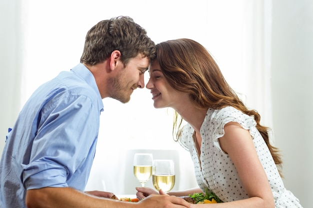 Romantic couple holding wineglasses