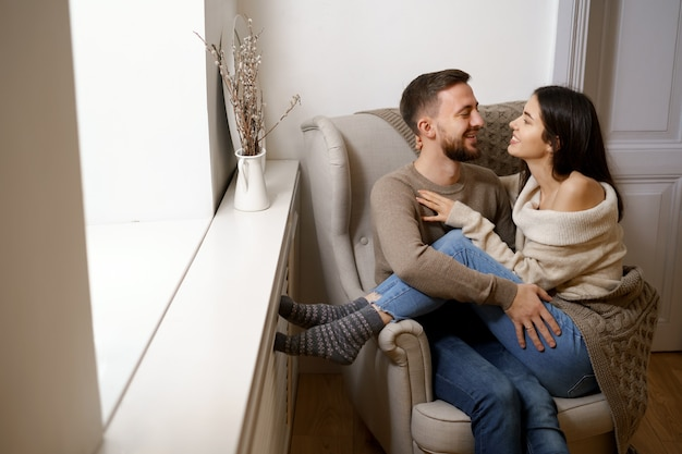 Romantic couple at home. an attractive young woman and handsome man are enjoying spending time