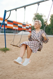 Romantic couple is having fun outside. enjoying spending time together on a swings.