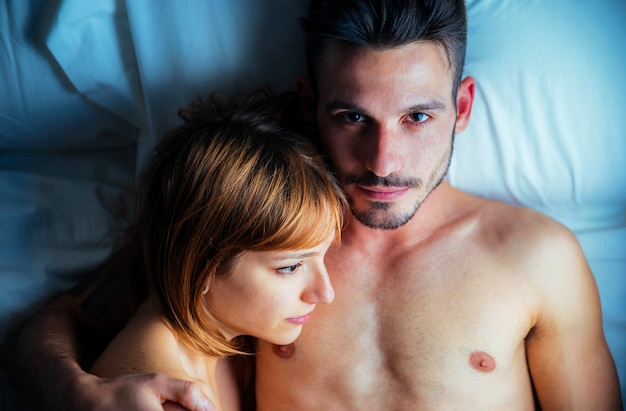 Romantic couple in love lying on the bed together