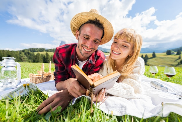 Romantic couple in love smiling reading travel diary