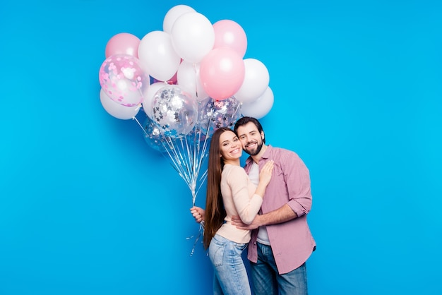 Romantic couple posing with balloons
