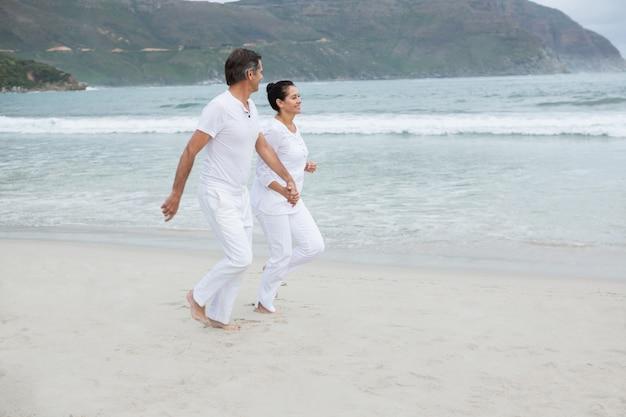 Romantic couple running on beach