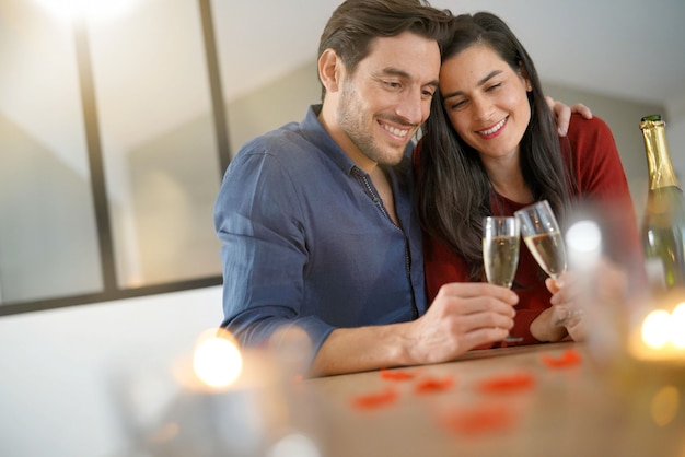 Romantic couple toasting with champagne for valentine's day