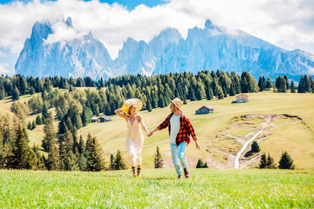 Romantic couple visiting alpe di siusi mountains, italy.