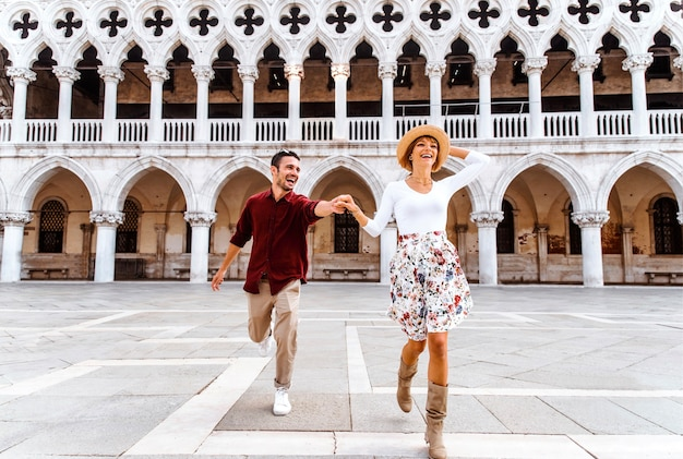 Romantic couple visiting piazza san marco in venice, italy