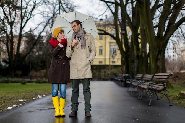 Romantic couple walkin in the rain