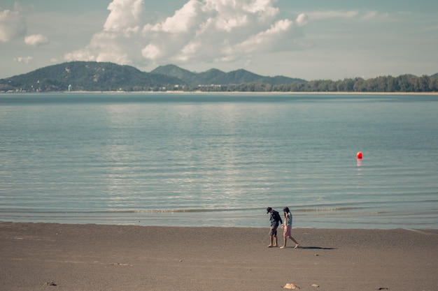 Romantic couples walking on the beach