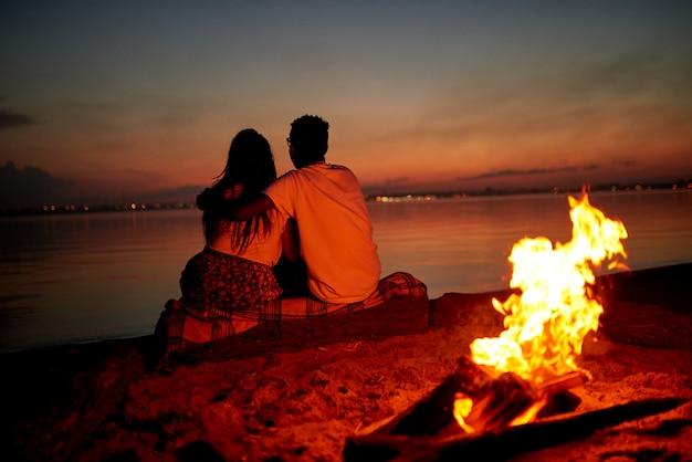 Romantic date on beach at night